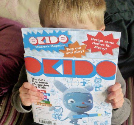 child holding Okido magazine Design issue #46