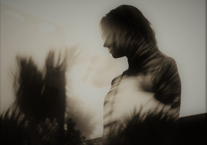 woman in shadows of nature