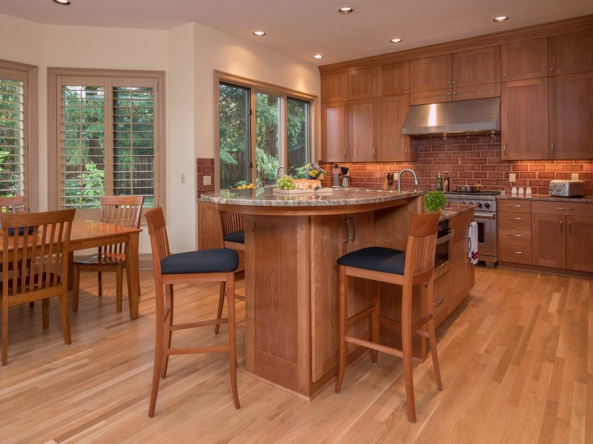 Contemporary Portland kitchen with wood floors and brick backsplash