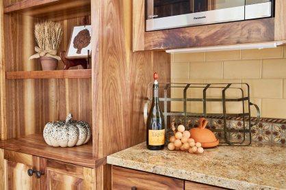 Wood Grain Cabinet with Autumn Decor