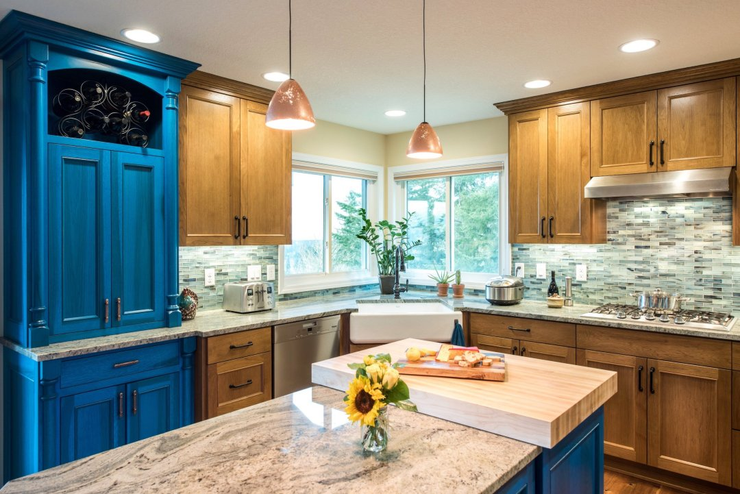 Kitchen Remodel with Texture and Blue Cabinet and Marble White Island and bay Window