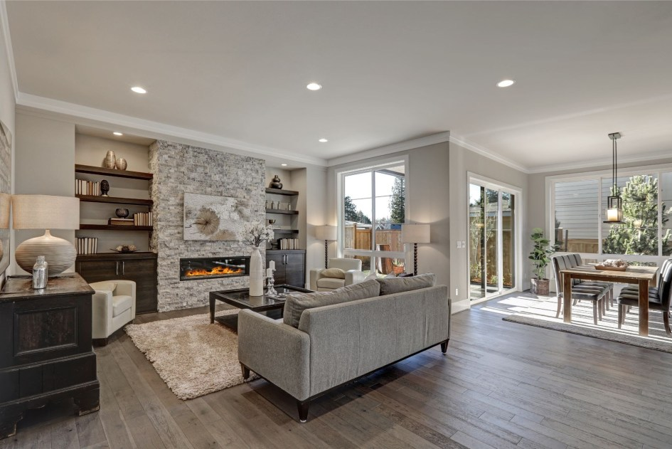 grey living room with a grey couch and grey floors