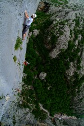 Jurica in the 3rd pitch during the competition, with Perica on belay at anchor 2. Photo: D. Pačić