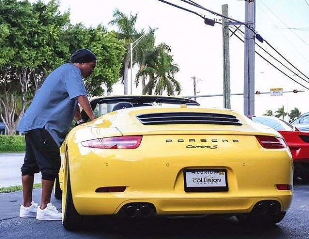 Image result for ronaldinho with his Bugatti Veyron