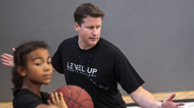 Basketball trainer coach bill from Level Up teaches defensive stance