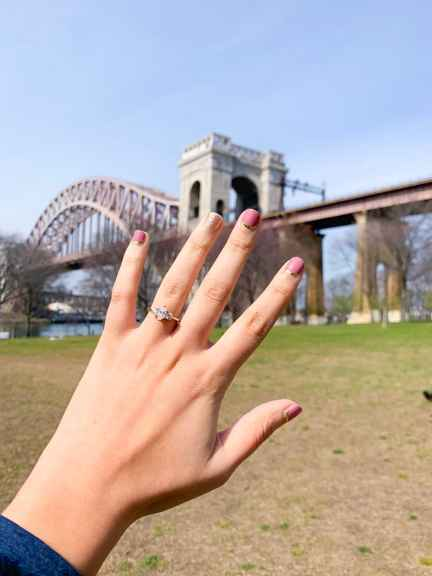 Looking for ways to practice self-care while you're social distancing? Do your nails!Image description: Ring selfie. A hand with an engagement ring held up to the scenery of Astoria Park and the Hellgate bridge.