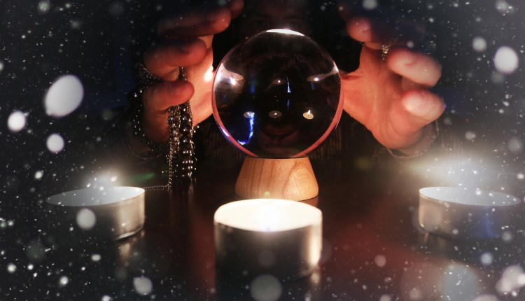 sorcerer hands over a transparent crystal ball fortune-telling for the future