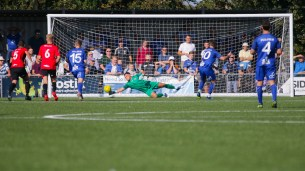 Lewis Carey saves the penalty