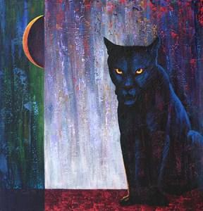 Intense black panther stares menacingly.