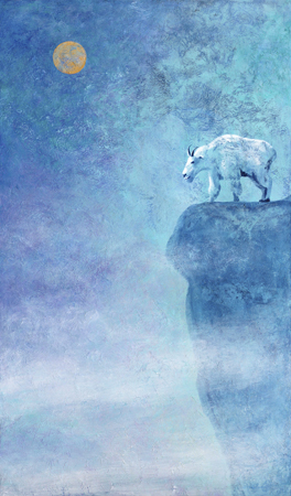 Mountain goat on a high cliff