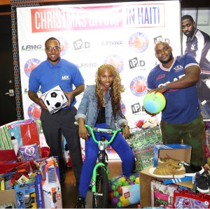 Givers in front of Christmas Giving in Haiti step and repeat.
