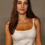 Flávia Campos - Marina's assistant, later dates Vanessa.