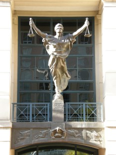 Justice statue on Albert V Brian Courthouse in Alexandria VA, USA