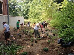 Students and faculty installing a garden at Moravian College that will be used for student research.
