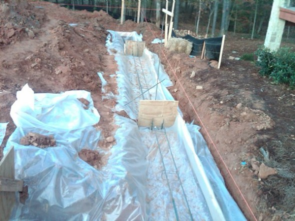 Proud Green Home Construction Update Foundation Footing 6 mill poly Capillary Break