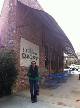 Jodi Laumer-Giddens in front of the Blue Eyed Daisy at Serenbe