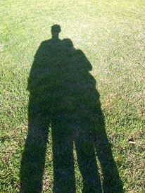 Image: Grass with shadow of two people