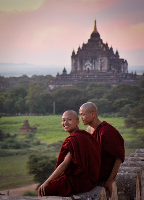young Buddhist monks enjoying sunset in Bagan