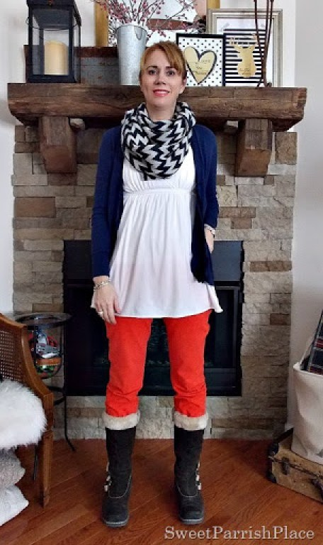 orange skinny jeans, white tunic, navy cardigan and chevron scarf with brown furry boots3
