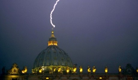 A lightning strikes St Peter's dome at the Vatican on February 11, 2013. Pope Benedict XVI announced today he will resign as leader of the world's 1.1 billion Catholics on February 28 because his age prevented him from carrying out his duties -- an unprecedented move in the modern history of the Catholic Church.      AFP PHOTO / FILIPPO MONTEFORTE