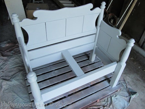spray painting a bench