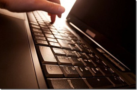 3532920-laptop-background-with-a-hand-hitting-a-key-in-the-back