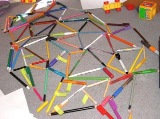 How We Homeschool - Part 1, Unit Studies Trains|  yellowreadis.com Image: Pens and pencils in network diagram on carpet