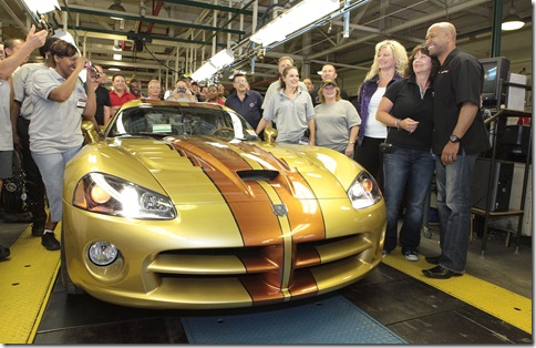 July 1 Ð Detroit Ð Dodge Brand President and CEO Ralph Gilles (right) and plant manager Shelly Brown Gordon (third from right) welcomed more than 400 hundred loyal Viper owners at the Conner Avenue Assembly Plant in Detroit today to present the ultimate factory customized 2010 Dodge Viper coupe to proud new owner D'Ann Rauh (second from right). Rauh and her husband Wayne from Arp, Texas, own more than 40 Dodge Vipers - the largest personal collection of Vipers in the world. A member of the Mid-South Viper Club of America, D'Ann Rauh worked exclusively with the Dodge Design team to select the personal touches she wanted on her car. The custom bronzed gold exterior paint was supplied by House of Kolor. The custom interior features various leather appointments, which were crafted by Tony Spampinito from Venzano, who has worked with the Rauhs on previous Viper projects. Bob Soroka, from Chrysler Group LLC's Street and Racing Technology team, airbrushed layouts of Viper-significant race tracks into the custom-painted copper stripes applied by Prefix. The five-spoke forged-aluminum wheels are custom painted in dark graphite. Members from both the Motor City Viper Club and the Viper Club of America participated in the celebration. Rauh's Viper is the last of the current-generation Vipers built at the plant. Dodge has created more special-edition Viper models for the 2010 model year than all other model years combined. Production on the Dodge Viper started in 1992. The Conner Avenue Assembly Plant will be idled while Dodge investigates a future-generation Viper. (Joe Wilssens photo)  For more information contact Dan Reid at 248-512-0366.