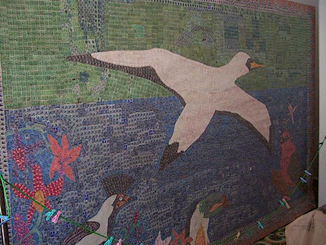 Mosaico hecho con timbres postales