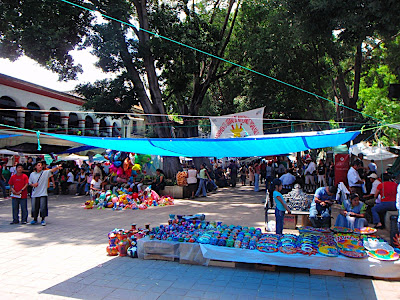 lots of people selling stuff and walking around in the zocalo
