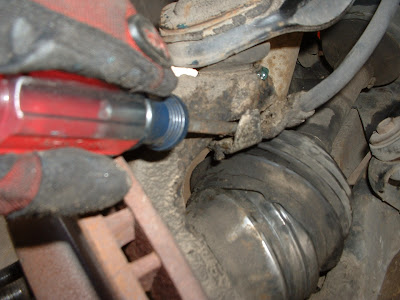 Then remove the brake line bracket from the ball joint stud.  This will allow you to move the brake caliper out of the way later.