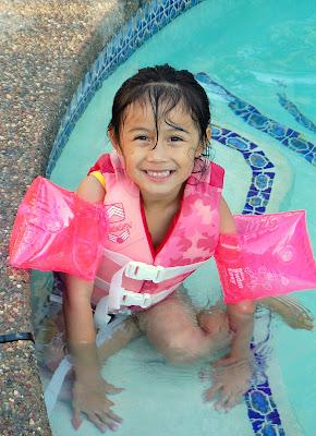 Khiara is learning how to swim.