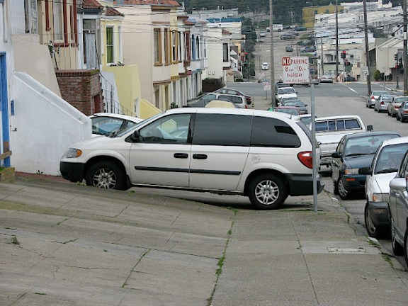 Drivers block sidewalks rampantly in the Sunset. Photo: ##https://i1.wp.com/lh3.ggpht.com/_TDLjiNdehOc/S0lRy49eiLI/AAAAAAAAAHM/vFb5FanOd6E/s640/IMG_0103.JPG?w=576&crop=0%2C0px%2C100%2C432px##SF Department of Sidewalk Parking##
