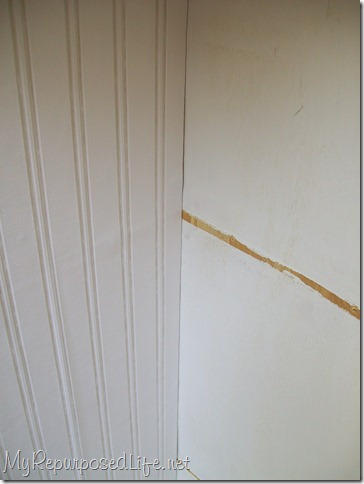 add bead board wall paper to back of diy corner cabinet