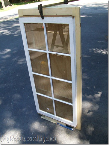 adding a window to a corner cabinet