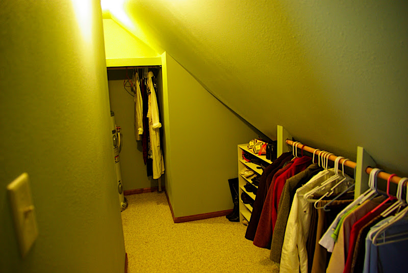 Because of the slanted ceilings, the hanging rack is low.  At the end of the closet on the left is a tall shelf for clothing and some drawers (you cant see it).  The closet is pretty spacious, though we may add some stuff to it to make it more functional.