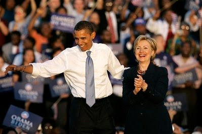 In this Oct. 20, 2008, file photo Democratic presidential candidate Sen. Barack Obama, D-Ill., left, and Sen. Hillary Clinton, D-N.Y. greet supporters at the end of a rally in Orlando, Fla. Former President Bill Clintons globe-trotting business deals and fundraising for his foundation sometimes put his activities abroad at odds with Sen. Hillary Rodham Clinton, and it could cause complications for her if President-elect Barack Obama considers her to be secretary of state. (AP Photo/John Raoux, File)