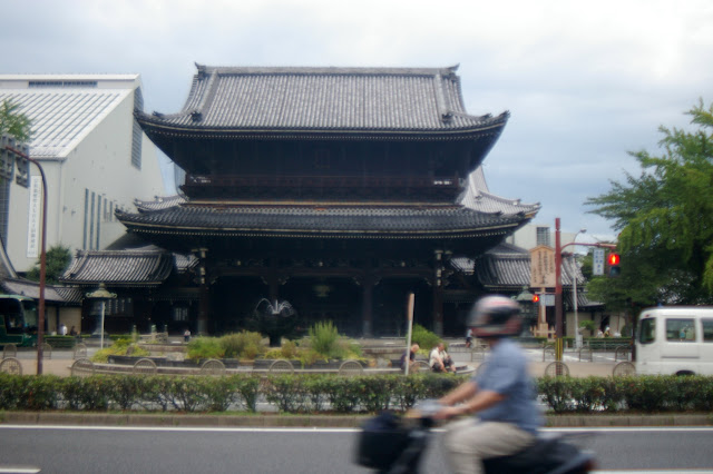 Kyoto temple w/ moped driver in foreground