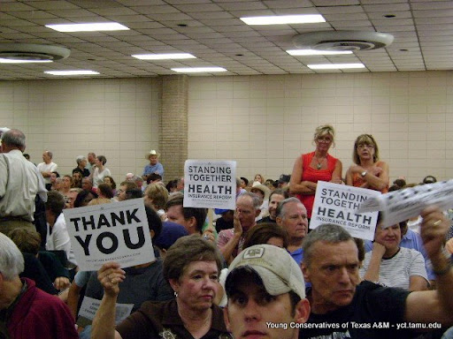 Obama supporters hold up supposedly banned printed signs