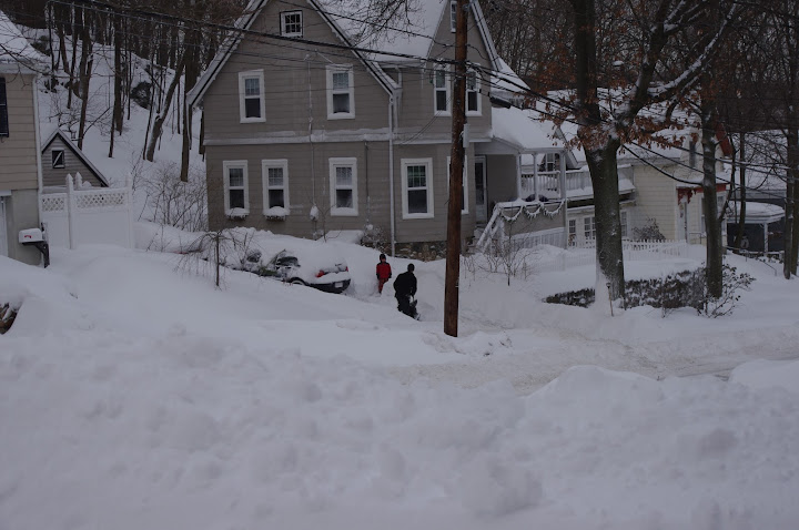 Snow shoveling is a neighborhood activity. We were all out today, and the kids played while we shoveled.