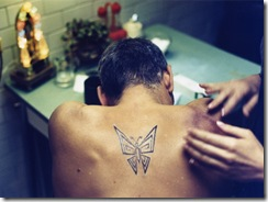 american_set_image_george_clooney_butterfly_tattoo_01