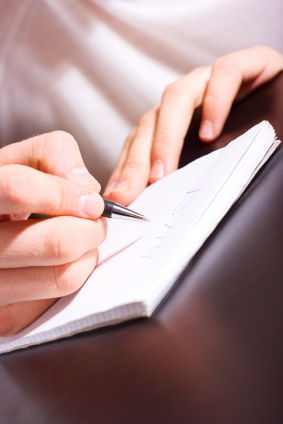 person_writing_on_paper-2.s600x600.jpg