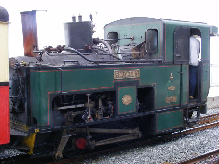 The train to the top of Snowdon seems to run partly on steam though the actual lifting is probably a rack and pinion affair. I dont really know much about trains...