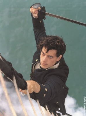 Lieutenant Hornblower climbs the rigging with a sword raised high