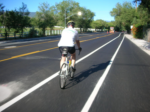 Roger Jacobson, head of Kiwanis Childrens Bicycle Program, rides a new bike lane on Mayberry