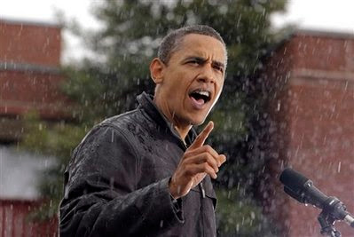 Democratic presidential candidate Sen. Barack Obama, D-Ill. addresses supporters in rain at a rally in Chester, Pa., Tuesday, Oct. 28, 2008. (AP Photo/Jae C. Hong)