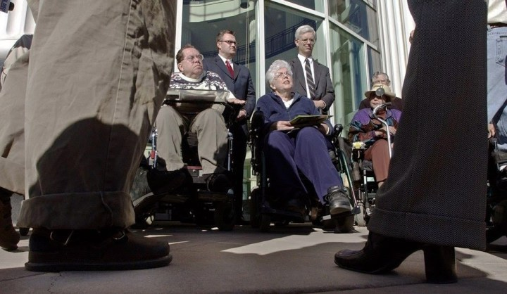 The Disabled Rights Action Committee members, L-R, Ted Loosli, Barbara Toomer, and Doris King, along with their attorneys talk to the media during a press conference outside the Scott Matheson Courthouse in Salt Lake City on October 17, 2002. The group announced three lawsuits that they are filing against Gateway developers The Boyer Co.