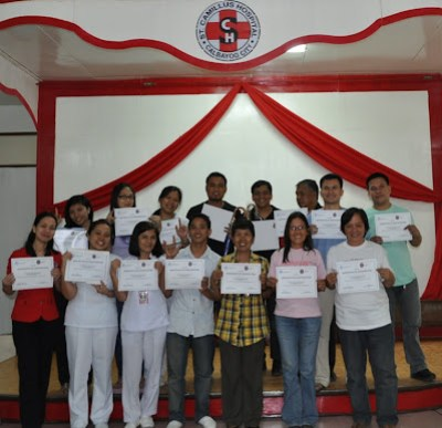 Participants displaying their certificates