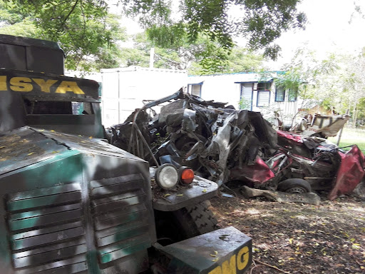 [For ' A cry for justice from the grave' story] Armoured vehicles used in the Ampatuan massacre sit alongside crumpled vehicles of the victims at the so-called 'evidence site' of the in regional police headquarters in General Santos city, Mindanao. The photo was taken on November 2, 2014.