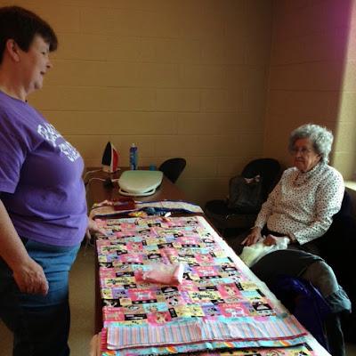 Karen and Luna selecting fabrics